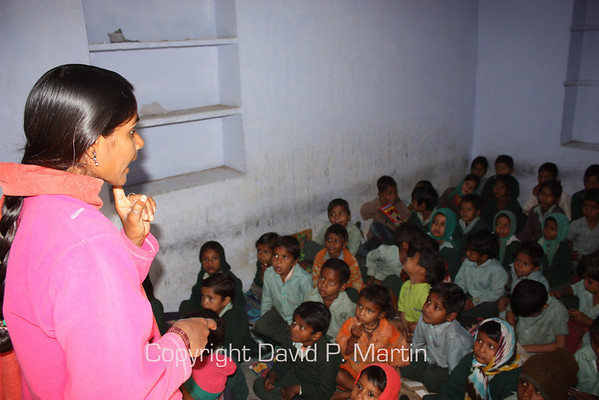 Teacher and students in a class room at the Saini Adarsh Vidhya Mandir School.