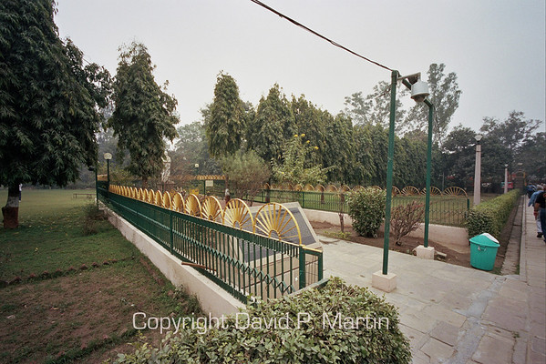 The Buddha's wheel is used as a decorative element in this fence on the Sarnath Temple grounds.