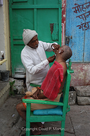 Shaving on the Varanasi ghat. After the oldest son cremates a family member, his head is shaved as a sign of mourning.