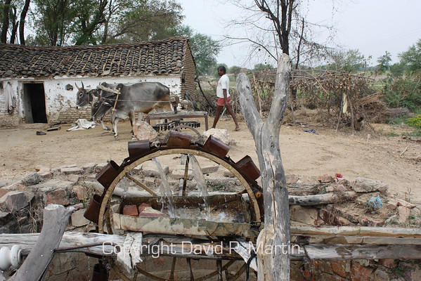A home made system to lift water from a well and distribute it to an irrigation ditch.
