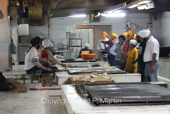 Preparing food for the needy at the Sikh temple.
