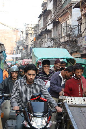 Street scene, Old Delhi. You'd have this expression too if you had to drive here.