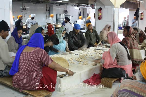 Preparing food at the Sikh temple.