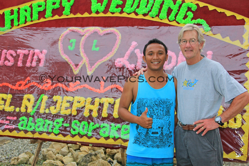 1552_05-25-15_Wedding signs_Marlynto_Tony.JPG<br /> Tony and Justin's older brother, Marlynto.  It is traditional for family and friends to send these billboard-sized greeting 'cards' to the bride and groom.  There were so many that they lined the whole street with them!
