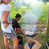 2438_05-29-15_Mo'ale Beach_Lyndall_Justin.JPG<br /> Justin works his magic with the coconut shells to bar-b-que fish for our lunch