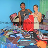 1158_05-20-15_Justin_Lyndall_Boardshorts.JPG<br /> I bought 56 pairs of used board shorts at thrift stores to give out to all the local kids and adults.  Lyndall & Justin sorted them and tried to set the right sizes aside for the many cousins and friends.
