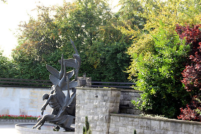 A statue of the Children of Lir, symbolizing rebirth and resurrection in The Garden of Remembrance.