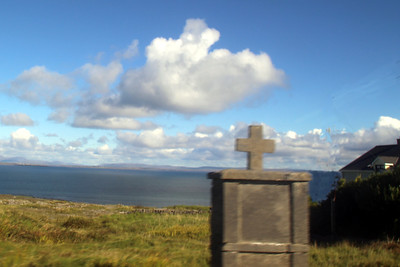 the mainland from Inishmore - the small monument in the foreground was erected in memory of someone lost at sea.