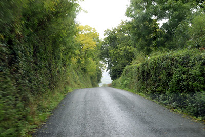 typical Irish road - narrow and lined with vegetation covered rock walls
