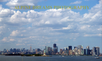 I call this NYC PANO     Besides the Statue of Liberty and the Iconic cityscape the High Clouds and Blue sky lit this scene nicely!