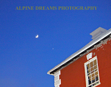 The thing that caught my eye with this scene was the moon lined up with the star as well as the faded-chipping paint of the bright red building.