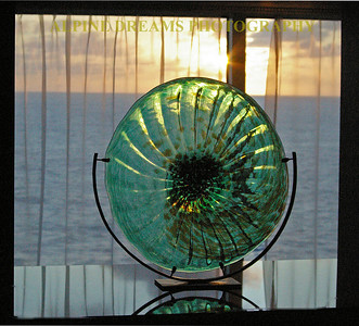 This artwork piece of green glass was on the ship near a window. I caught the sun coming through it making it more vibrant.