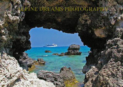 The hole in the Coral gave me a perfect picture frame for the Cruise Ship going by. I believe this was Horseshoe  beach.