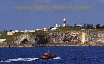 This scene could be in New England with the rock band, the lighthouse and the tug.  Very Diverse in Bermuda