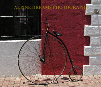 One of my favorite shots of an old-time bicycle. It was in very good shape and stood out well next to the Red & White building. You can guess by the Shadow that it was almost Lunch time!