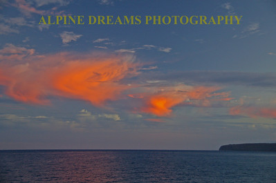 These beautiful clouds showed up in the back sky of one of the great sunsets to be seen at Sea.  Note the reflection of the cloud on the water.