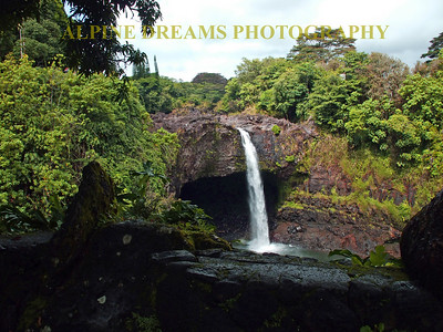 A waterfall on a cludy day in Kauai. Note the lava rock.
