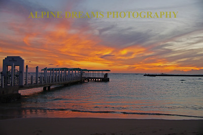 This dock at Wakaki beach gave a nice angle to pull in this picture with the rock jetty in the background. The sky was the superstar in this shot as the sun just went down leaving the sky ablaze.