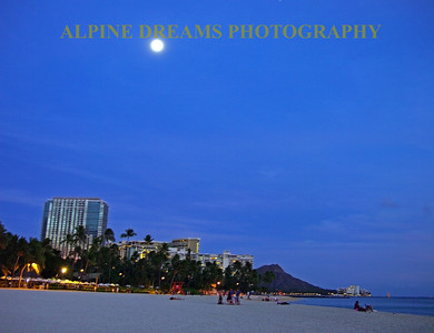 Believe it or not that is the full moon over diamond head just before the sunlight behind me gave up for the night.