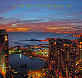From a high perch I was able to grab this shot as the sun was leaving for the day. The lights of the high rises and the sky and water brought this scene together in Honolulu.
