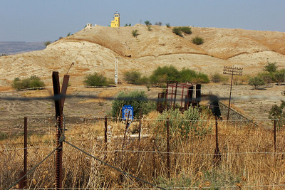 7-Background: border observation tower. Foreground, old rail cars on Haifa-Damascus line.