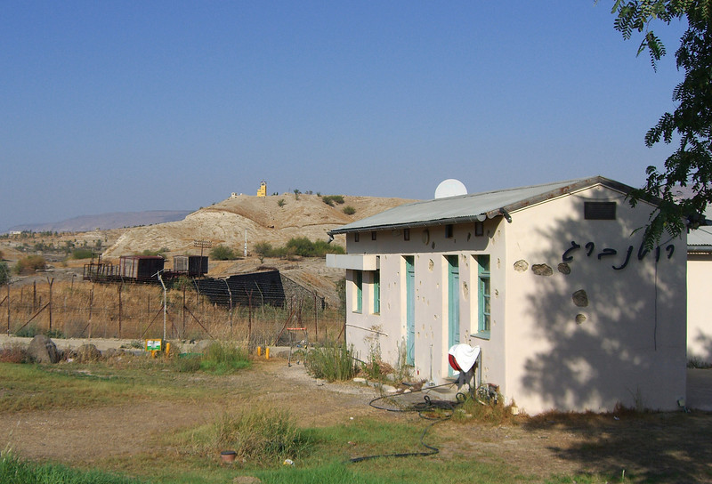 8-Foreground: Rutenberg Restaurant with bullet holes and shrapnel. Background: border observation tower in Jordan.