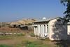 8-Foreground: Rutenberg Restaurant with bullet holes and shrapnel. Background: border observation tower in Jordan.