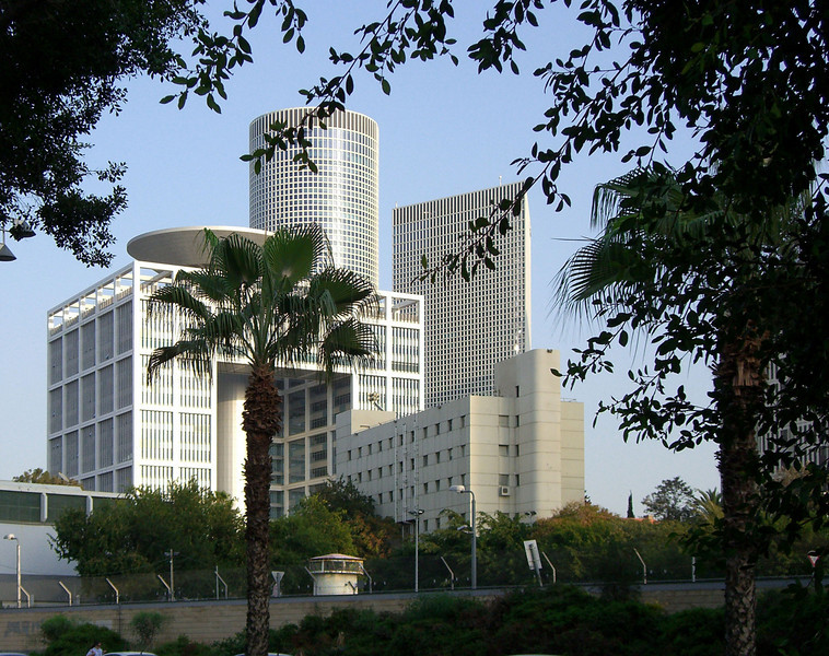 "57-""HaKirya"" (IDF HQ). Front: the Matcal Tower (general staff building). Note the guard tower (foreground). Rear (across Derech Menachem Begin): Azrieli Center towers (49 and 46 stories)."