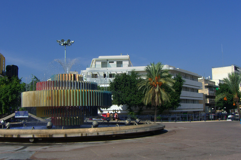 3-This Bauhaus style office building is on the NNW side of the square, between Ben Ami and Dizengoff Streets. Kinetic sculpture/fountain by Yaakov Agam, 1986.