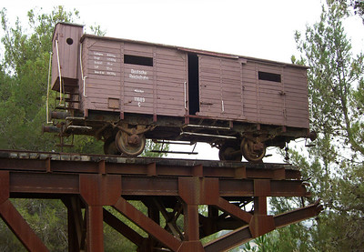 "18-Boxcar for transporting 100 people to death camps. An original German cattle car given to Yad Vashem by Polish authorities. The German reads ""German Railways, Munich."""