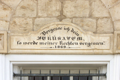 "17-Lintel over the door to the City Museum: ""If I forget thee Jerusalem, let my right arm forget"" [its skill. Psalm 137:5]"