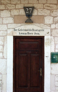 "13-German Colony, doorway to #27. ""The Spirit and the Bride say come, Jesus."" [Revelation 22:17]"