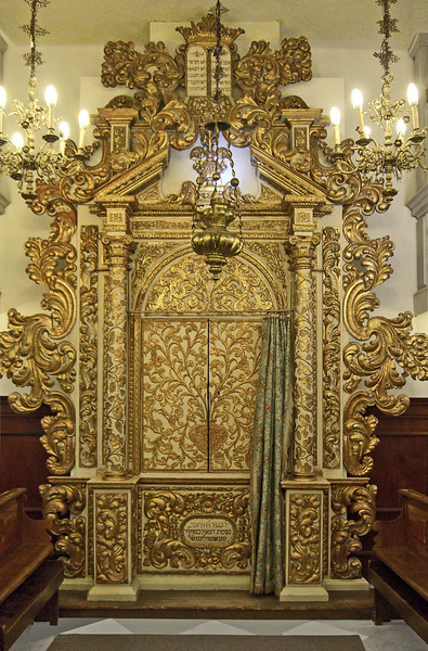 57-The Torah Ark (1652) is older than the Conegliano Synagogue (1701). Parts of the Ark are even older. Below the doors is a dedication to Rabbi Nathan Ottlengo who headed Conegliano Yeshiva until his death in 1615.