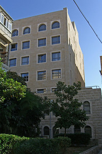 3-Harmony Hotel, rear. My room is one floor below the top floor and at the far left. The window is open (dark square).
