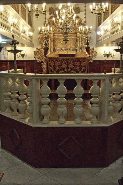 56-On entering the Conegliano Veneto Synagogue, you look east, over the Bimah to the Ark. The original synagogue was in use until 1918. In 1951, Italian Jews transferred the synagogue interior to the Schmidt Compound, where the Italian Jewish community already gathered to pray.