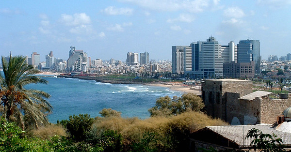 Those same buildings are on the far right in this 2004 photo taken from Jaffa. Below them, low building on beach is  Manta Ray restaurant — exceptional food.