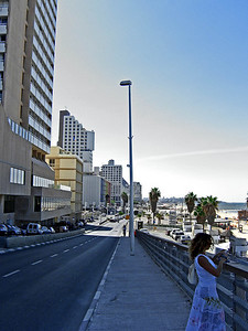 One-way road runs southbound between hotels and beach. My hotel (Yamit) is the tall block just to left of light pole.