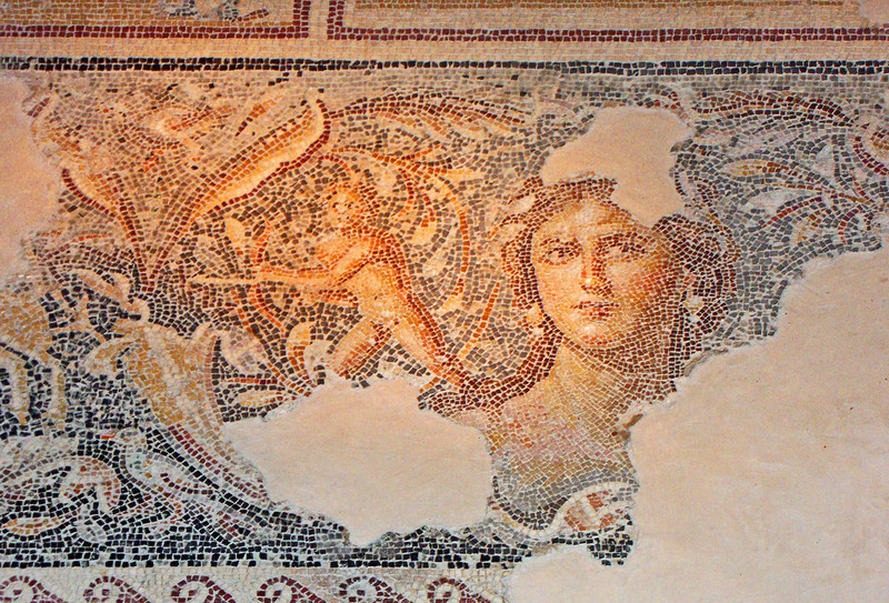 "19-""Madonna of the Galilee""—the centerpiece of the mosaic floor in the Roman Villa—is a young woman, rendered more life-like and more detailed than most mosaics (note the shading and blush of her cheeks)."