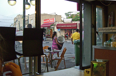27-Our last stop—a baklava shop for sweets and coffee—and looking out toward the Mona Lisa florist (maroon awning). From here, Eli drove us back to the French Carmel, picked up Na'ama (who was staying with a friend), and dropped me at Colony Hotel, well down the hill in central Haifa. All-in-all, a great touring day for me!