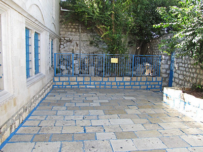 27-Abohav Synagogue. Salvaged stones are kept behind the fence in this entry courtyard.