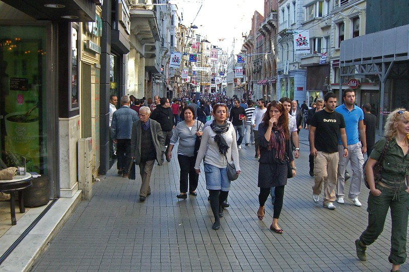 52-İstiklâl Çaddesi (Independence Avenue) on a Thursday. It is visited by nearly 3 million people on a single weekend day. The pedestrian street (three kilometers long) is lined with boutiques,  bookstores, art galleries, cinemas, cafés, pubs, night clubs  and restaurants. The avenue starts from the medieval Genoese neighbourhood around Galata Tower and  leads up to Taksim Square.