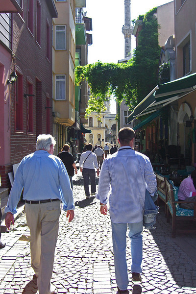 37-Abba Niv and guide Atilla Ershan negotiate Ortaköy's narrow streets, lined with cafes and boutiques, almost under the shadow of the suspension bridge.