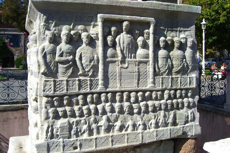127. Base of Egyptian Column. Theodosius mounted the obelisk on this marble base, carved with images of himself and his wife.
