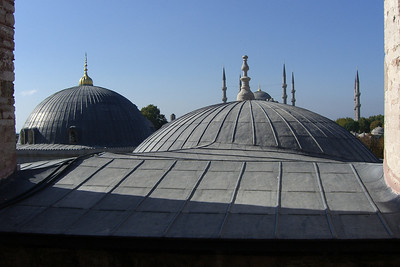 74. Looking from inside Hagia Sophia (Aya Sofya) and across its domes to the Blue Mosque and its six minarets.