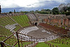 #0474 Pompeii Theater<br /> Using the slopes of the hillsides the Pompeii Theater could hold 5,000 people. The seats were numbered and each individual was allowed 15 3/4 inches for their seating space. The Gladiator living and training quarters were next to the theater.