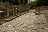 0384 Pompeii Street<br /> Streets were paved with stone blocks. There were raised stones at regular intervals used by pedestrians to cross the street when it rained. The streets were also built to be used as gutters running out of the city. Ruts, worn in the rocks  from the wheels of Roman Chariots, can still be viewed in the streets