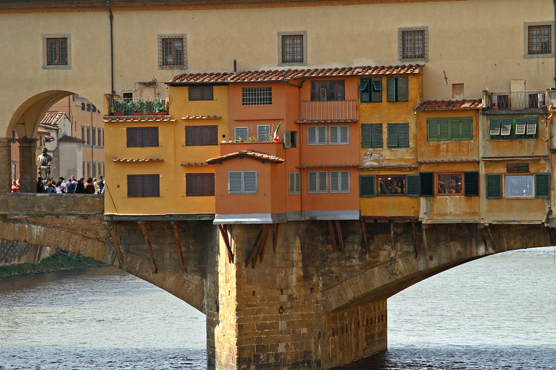 #0216 Ponte Vecchio<br /> First built in Roman times and reconstructed in 1345 after being destroyed, for a second time, in 1333. The bridge still has shops, Jewelers, Art Dealers and souvenir venders, on it. The original merchants were Butchers. When the Germans retreated in Aug. 1944 this was the only bridge across the Arno River left in tact. Buildings on both ends were destroyed, but was easily cleared by the allies advancing across the Arno.