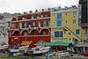 #0324 Capri<br /> Capri's businesses start at the harbor. The hotels and restraunts are right next to the docks. The Government does not allow the owners of any buildings to alter their appearance. If they need repair or painted they have to keep it the same as it has been in the past.