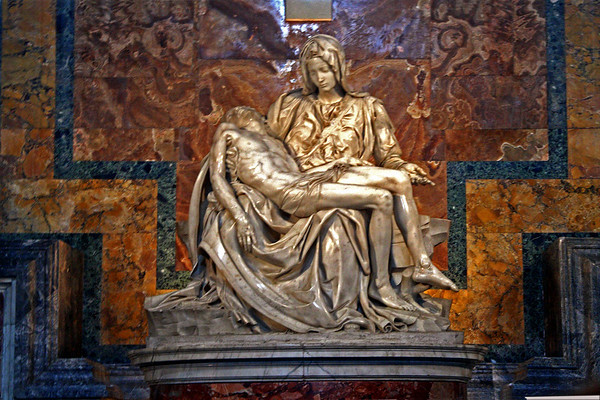#0065 Michelangelo's Pieta<br /> A Marble sculpture in St. Peter's Basilica in the Vatican City. It was made for Cardinal Jean de Billheres funeral monument but was placed in the first chapel on the right as you enter St. Peter's. It depicts Mary holding  Jesus's body after he was crucified.