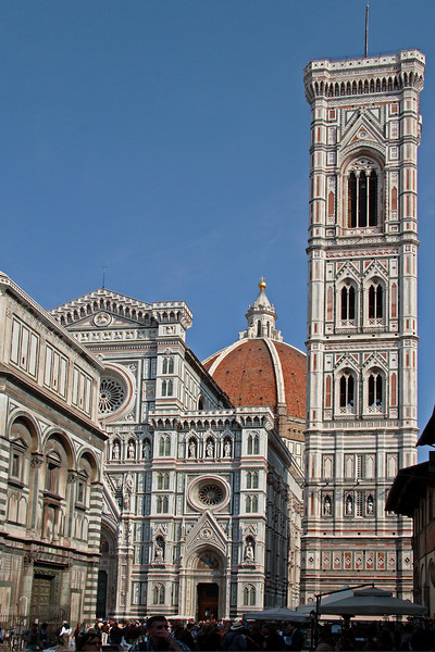 #0223 Giotto's Bell Tower<br /> Construction was started around 1334 and continued through the completion of the Dome in 1436. It's sides are 47.41 feet with it being 277.9 feet tall. This Florentine Gothis style structure is devided into five levels and is built on the Cathedral square in Florence Italy.